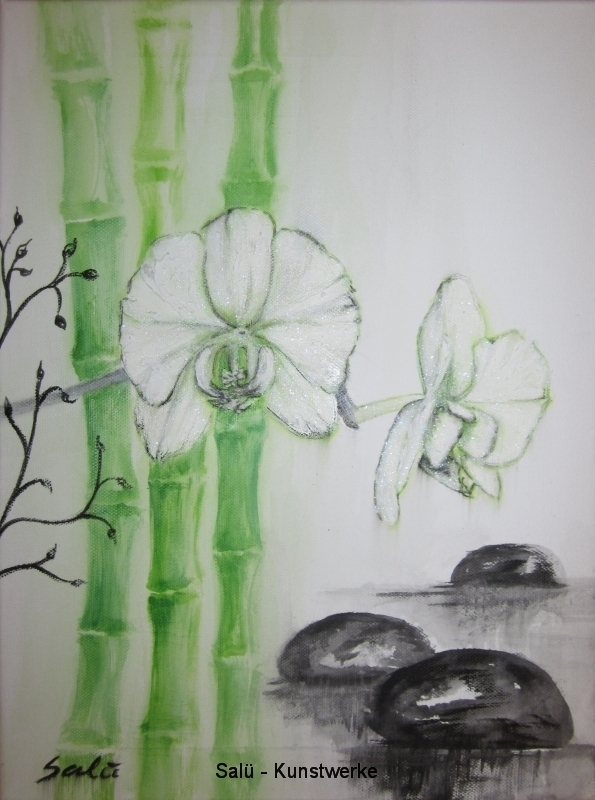 Weiße Orchidee mit Bambus